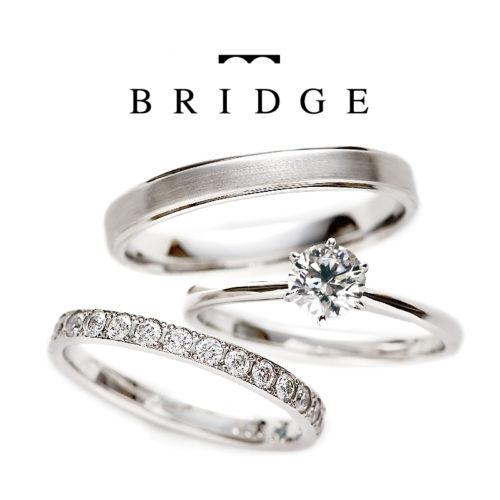 ブリッジのセットリングで一輪の薔薇と煌めく水面